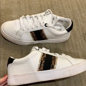 White sneakers with leopard detail